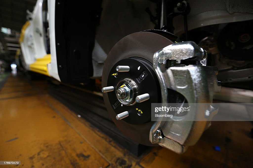 The wheel of a vehicle is seen on the halted assembly line at the Hyundai Motor Co. plant during a strike by the company's labor union in Ulsan, South Korea, on Tuesday, Aug. 20, 2013. Union members at Hyundai Motor, South Korea's largest automaker, staged a partial strike today that will continue tomorrow as they demand higher wages amid increasing competition with Japanese carmakers. Photographer: SeongJoon Cho/Bloomberg via Getty Images