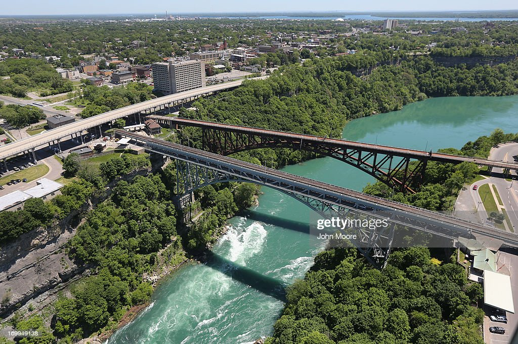 The Whirlpool Bridge crosses from the United States (L), into Canada over the Niagara River on June 4, 2013 at Niagara Falls, New York. The falls, which have a combined highest flow rate of any waterfalls in the world, stradle the U.S.-Canada border, on the the Niagara River, which drains Lake Erie into Lake Ontario. The falls, visited by millions of tourists on each side of the border, are also a major source of hydroelectric power for the region. The aerial view was seen from a helicopter flown by the U.S. Office of Air and Marine, (OAM), which monitors and patrols the U.S. northern border with Canana.