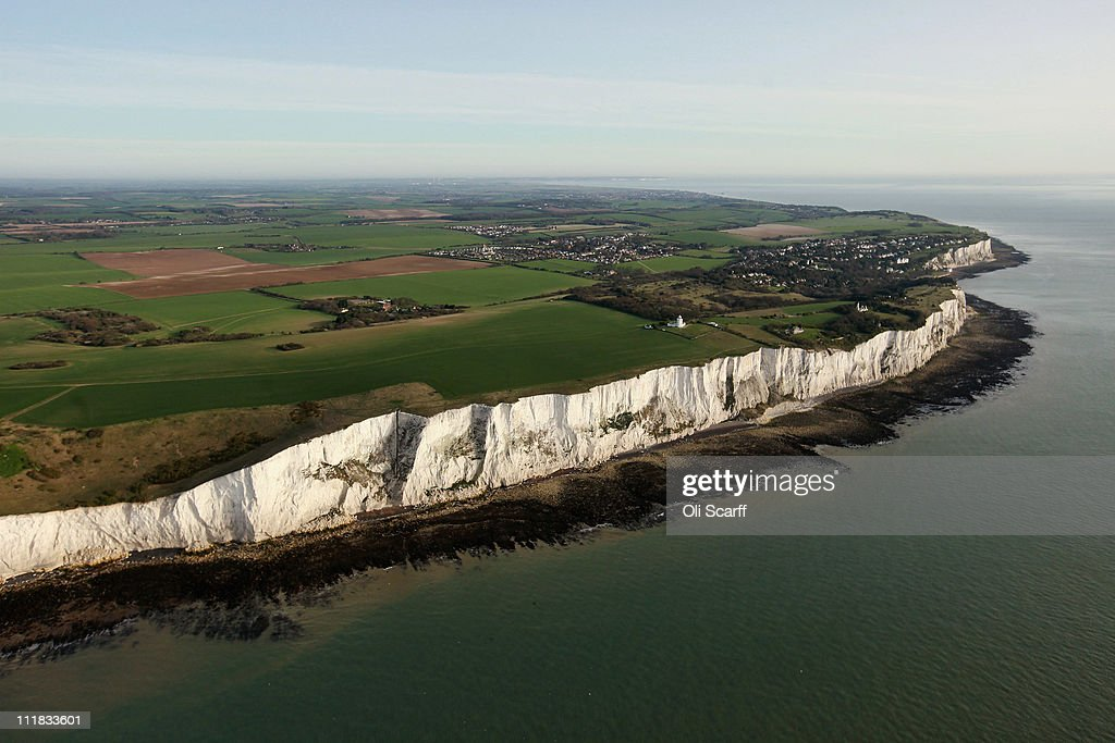 The white cliffs of Dover and the South Foreland lighthouse are seen from the air on April 7 2011 in Dover England The chalk cliffs which at points...
