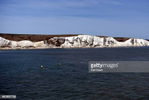 The White Cliffs of Dover are pictured from a cross channel ferry on March 13 2017 in Dover England The White Cliffs of Dover are identified as a...