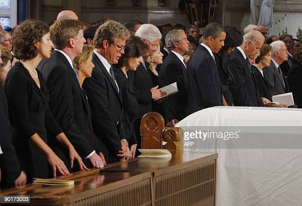 The white draped casket of US Senator Edward Kennedy sits in front of the Senator's stepdaughter Caroline Raclin his son Congressman Patrick Kennedy...