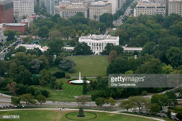 The White House and the South Lawn and part of the Ellipse are seen from the observation deck of the Washington Monument October 1 2014 in Washington...