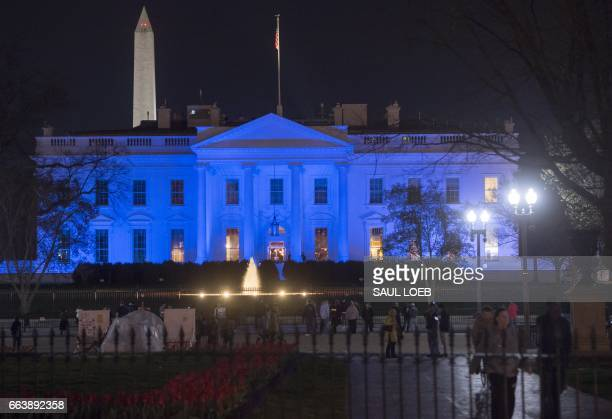 The White House is lit in blue in honor of World Autism Awareness Day in Washington DC April 2 2017 / AFP PHOTO / SAUL LOEB
