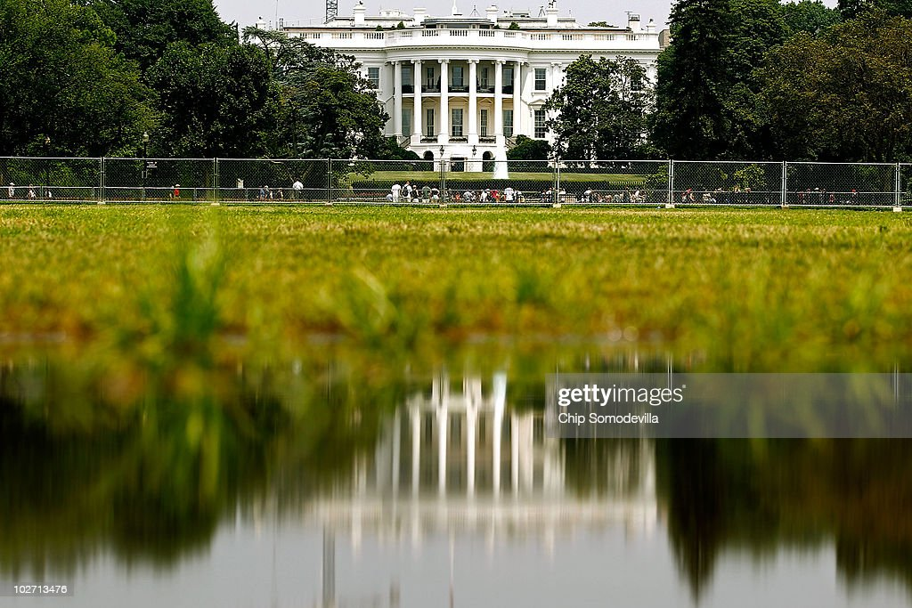 The White House is reflected in a puddle on the Eclipse July 8, 2010 in Washington, United States. Temperatures on the East Coast reached the mid-90s by midday on Thursday, showing a break in the 100-degree days from earlier in the week.
