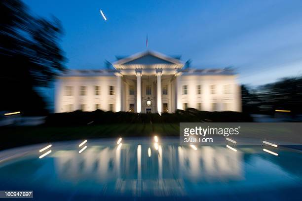 The White House is seen at dusk as illuminated by lights from the North Lawn in Washington DC on October 7 2008 AFP PHOTO / Saul LOEB