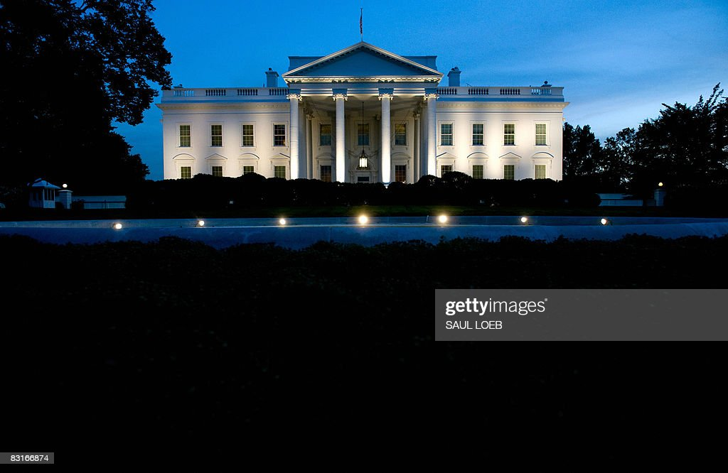 The White House is seen at dusk as illuminated by lights from the North Lawn in Washington, DC, on October 7, 2008. AFP PHOTO / Saul LOEB