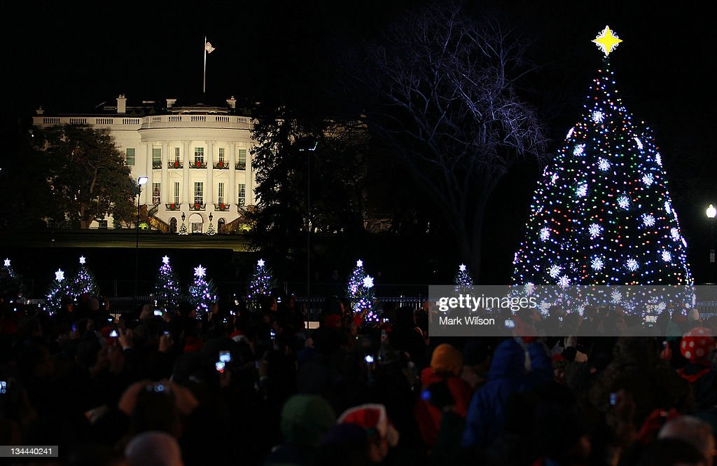The White House is seen in the background after the National Christmas Tree was lit during its lighting ceremony, on December 1, 2011 at the Ellipse, south of the White House, in Washington, DC. The first family participated in the 89th annual National Christmas Tree Lighting Ceremony.