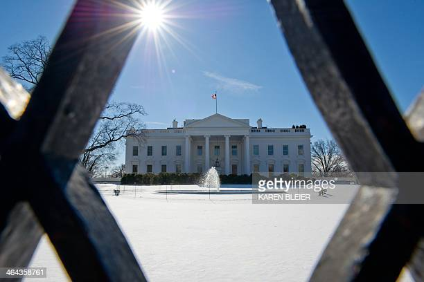 The White House is seen January 22 2014 on a cold day in Washington DC Millions of Americans braved a miserable commute across the East coast...