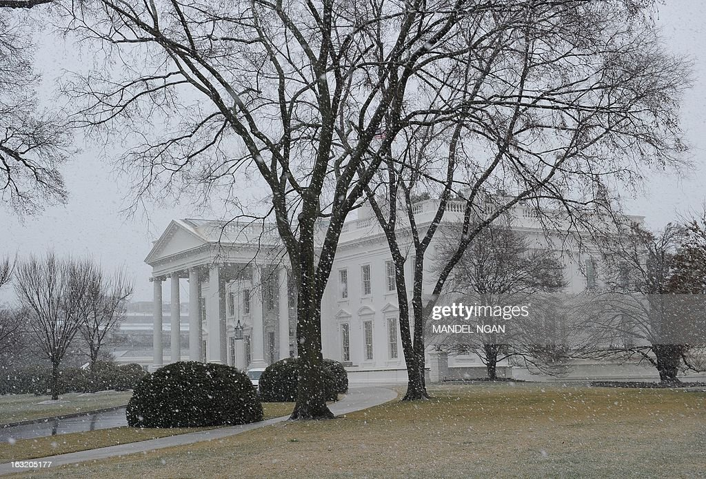 The White House is viewed with snowfall on March 6, 2013 in Washington, DC. A winter storm warning remains in effect until early Thursday. A massive winter storm pounding the northern United States Tuesday grounded 2,600 flights, closed hundreds of schools and made roadways and highways impassible. At least four people were reportedly killed in accidents on icy and snow covered roads and highways. More than a dozen states from Minnesota to Virginia were in the path of the huge storm, which had already dumped as much as two feet (60 centimeters) of snow in Montana and 15 inches (38 centimeters) in North Dakota. Mandel NGAN