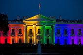 The White House stands illuminated in rainbow colored light at dusk in Washington DC US on Friday June 26 2015 The Supreme Court's ruling that gay...