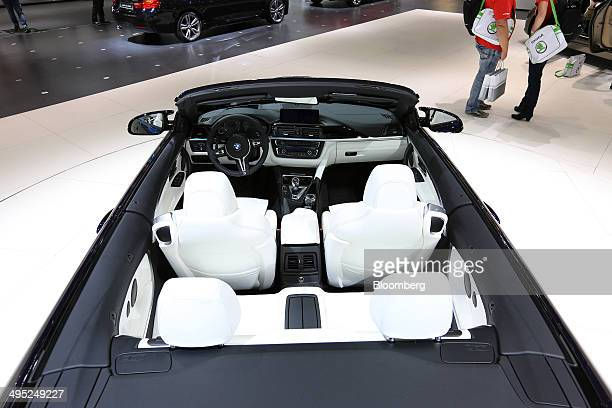 The white leather upholstery of a convertable BMW M3 Cabrio automobile produced by Bayerische Motoren Werke AG is seen at the company's stand at the...