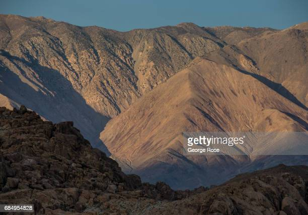 The White Mountains are viewed at sunset from Highway 395 on April 6 in Lone Pine California Owens Valley is an arid valley in eastern California to...