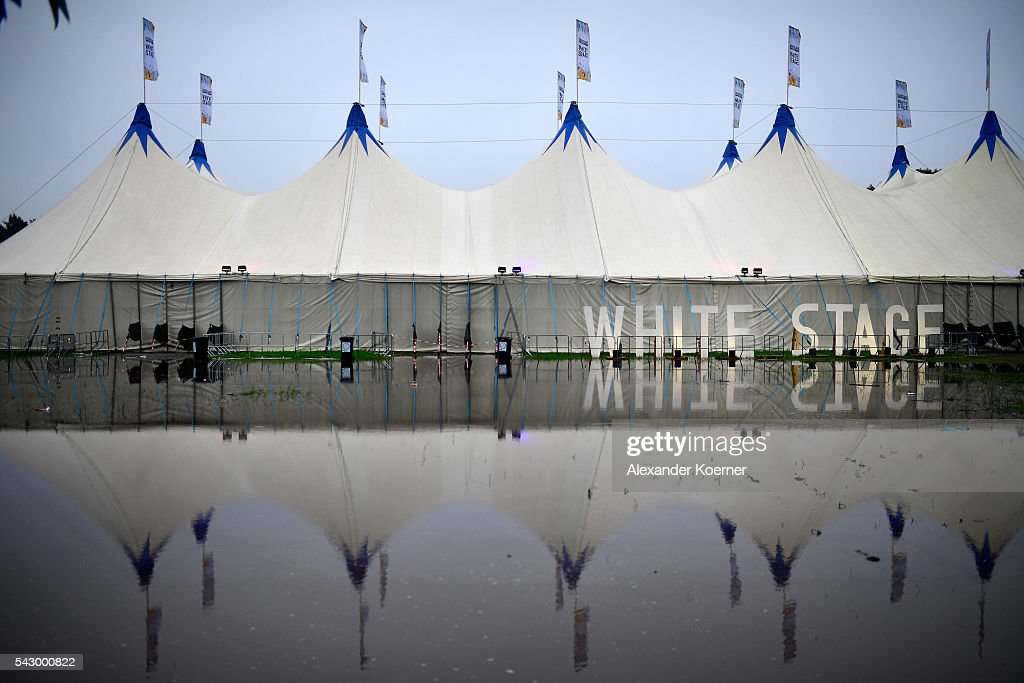 The White Stage is reflected in a puddle at the Hurricane Festival compound on June 25, 2016 in Scheessel, Germany. The Hurricane Festival was evacuated yesterday and was delayed today for the late evening, following heavy rain and thunderstorm alerts. The rain and thunderstorm have hit the festival during the night and day, causing damage to tents and flooded the festival site, only 7 concerts can be played on two stages today. The Hurricane Festival celebrates this year its 25th anniversary. 75.000 music fans have visited the Festival, but some thousands have already left the compound due to the current situation.