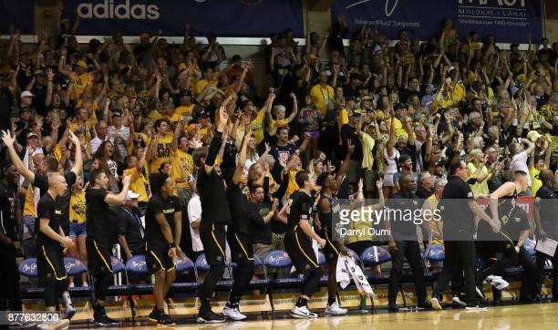 The Wichita State Shockers bench and fans celebrate a point during the first half of the game against the Notre Dame Fighting Irishat the Maui...
