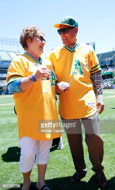 The widow of Catfish Hunter talks with former Oakland Athletics Bert Campaneris following a pregame ceremony before the game between the Athletics...