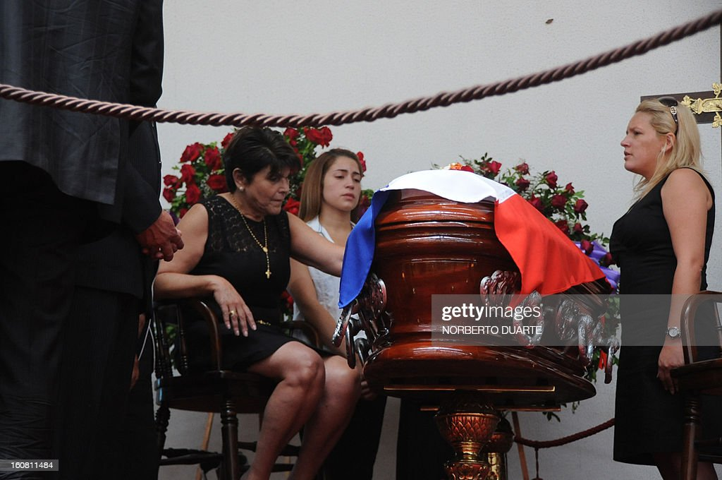 The widow of former general and presidential candidate of the UNACE party, Lino Oviedo -- who died along with his bodyguard Denis Galeano and pilot Ramon Picco Delmas in a helicopter crash on February 2-- Raquel Marin de Oviedo (L) and UNACE party deputy Dabiola Oviedo (R) mourn him during his wake in Asuncion, on February 6, 2013. Oviedo, 69, the controversial presidential candidate who helped topple Paraguayan dictator Alfredo Stroessner in 1989, died when the aircraft crashed en route to Asuncion while returning from a campaign rally in northern Paraguay, prompting claims of foul play. AFP PHOTO /Norberto Duarte