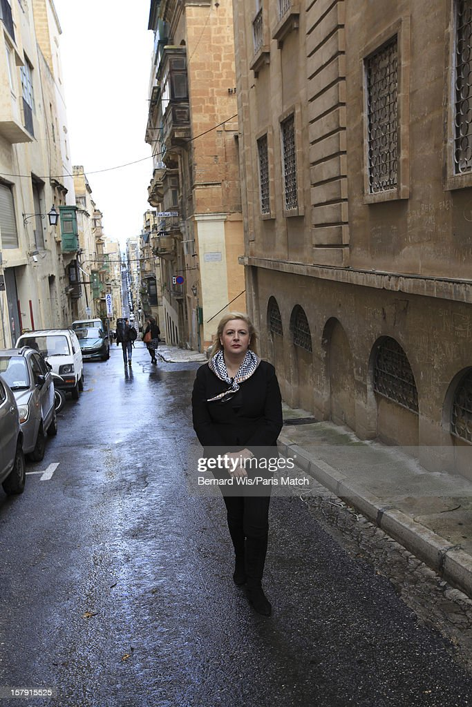The widow of former Palestinian leader Yasser Arafat, Souha Arafat is photographed at home with her daughter Zahwa for Paris Match on November 28, 2012 in Valletta, Malta.