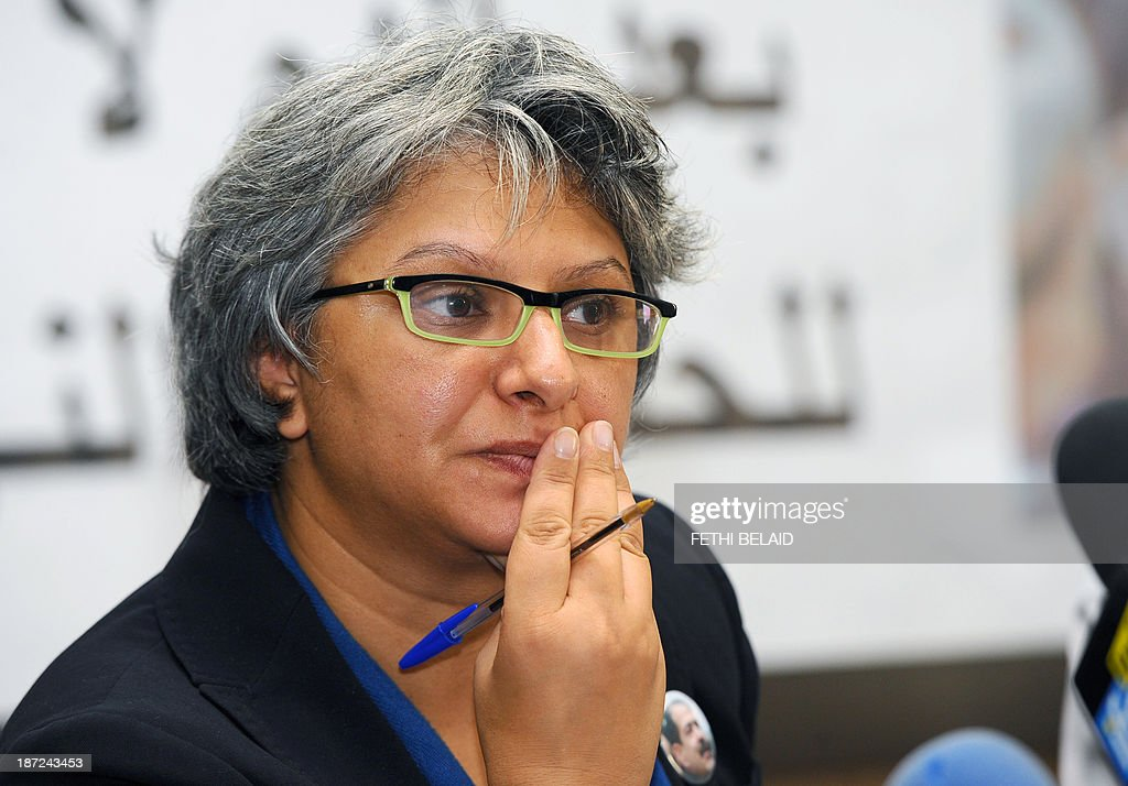 The widow of murdered opposition figure Chokri Belaid, Basma Khalfaoui listens during a press conference of the 'Initiative for the Search for Truth about the Assassination of Chokri Belaid and Mohamed Brahmi' (IRVA) group on November 7, 2013 in Tunis to present new documents related to the assassination of the two opposition politicians. IRVA accused the Tunisian Ministry of Interior of 'hidding' ballistic test results conducted in the Netherlands, which would show that Belaid was assassinated on February 6, 2013 with a gun 'belonging to the Interior Ministry'.
