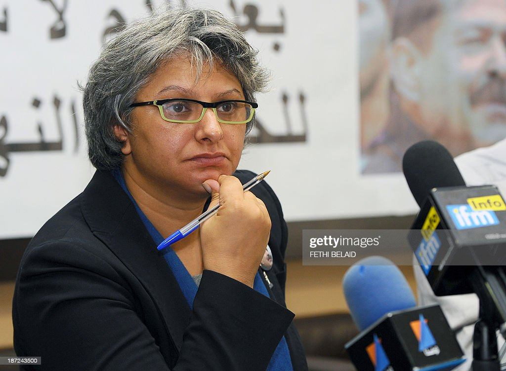 The widow of murdered opposition figure Chokri Belaid, Basma Khalfaoui attends a press conference of the 'Initiative for the Search for Truth about the Assassination of Chokri Belaid and Mohamed Brahmi' (IRVA) group on November 7, 2013 in Tunis to present new documents related to the assassination of the two opposition politicians. IRVA accused the Tunisian Ministry of Interior of 'hidding' ballistic test results conducted in the Netherlands, which would show that Belaid was assassinated on February 6, 2013 with a gun 'belonging to the Interior Ministry'.