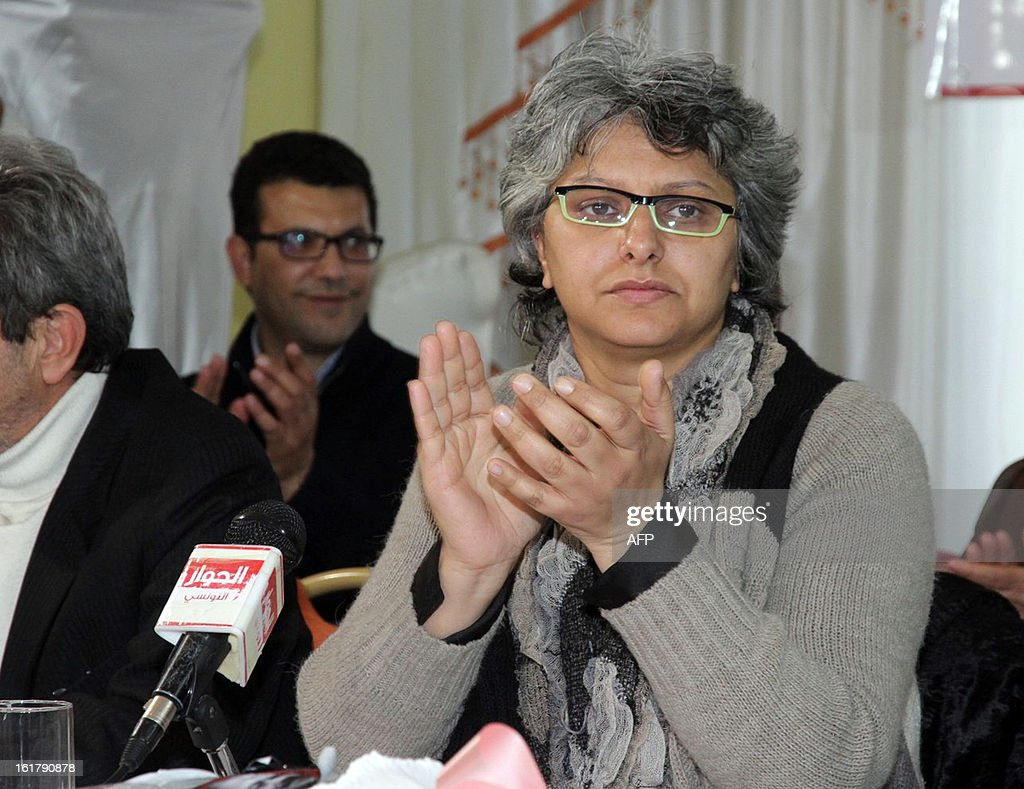 The widow of murdered opposition figure Chokri Belaid, Besma Khalfaoui applauds during a meeting with representatives of the Tunisia's leftist opposition alliance, Front Populaire, to pay tribute to Belaid on February 16, 2013 in Belaid's hometown Jandouba, northwestern Tunisia. Besma Khalfaoui has become a symbol of Tunisia's secular opposition and scourge of the ruling Islamists.