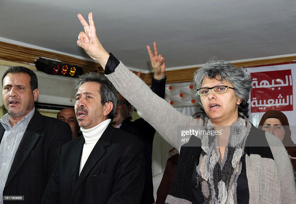 The widow of murdered opposition figure Chokri Belaid, Besma Khalfaoui flashes the sign of victory during a meeting with representatives of the Tunisia's leftist opposition alliance, Front Populaire, to pay tribute to Belaid on February 16, 2013 in Belaid's hometown Jandouba, northwestern Tunisia. Besma Khalfaoui has become a symbol of Tunisia's secular opposition and scourge of the ruling Islamists.