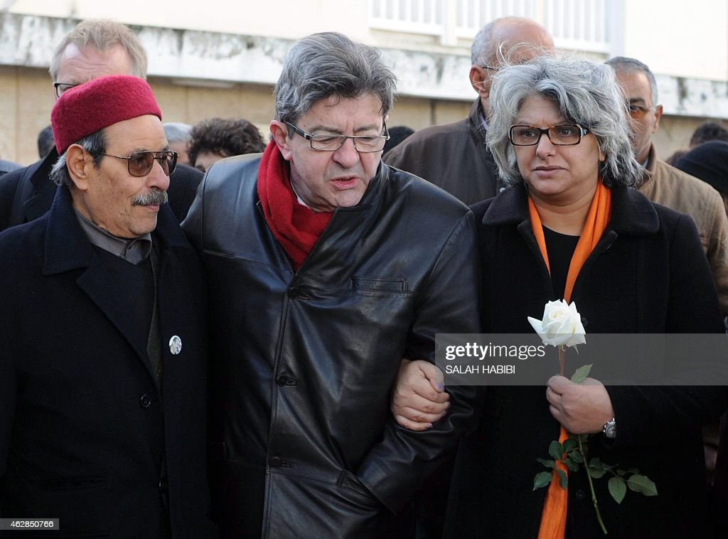 The widow of murdered Tunisian opposition figure Chokri Belaid, Basma Khalfaoui (R), his father Salah Belaid (L) and French left wing party Front de Gauche (FG) leader Jean-Luc Melenchon (C), attend a ceremony marking the second anniversary of his death, on February 6, 2015 in the capital Tunis. Belaid, an anti-Islamist politician, was shot dead by suspected jihadists two years ago. AFP PHOTO / SALAH HABIBI