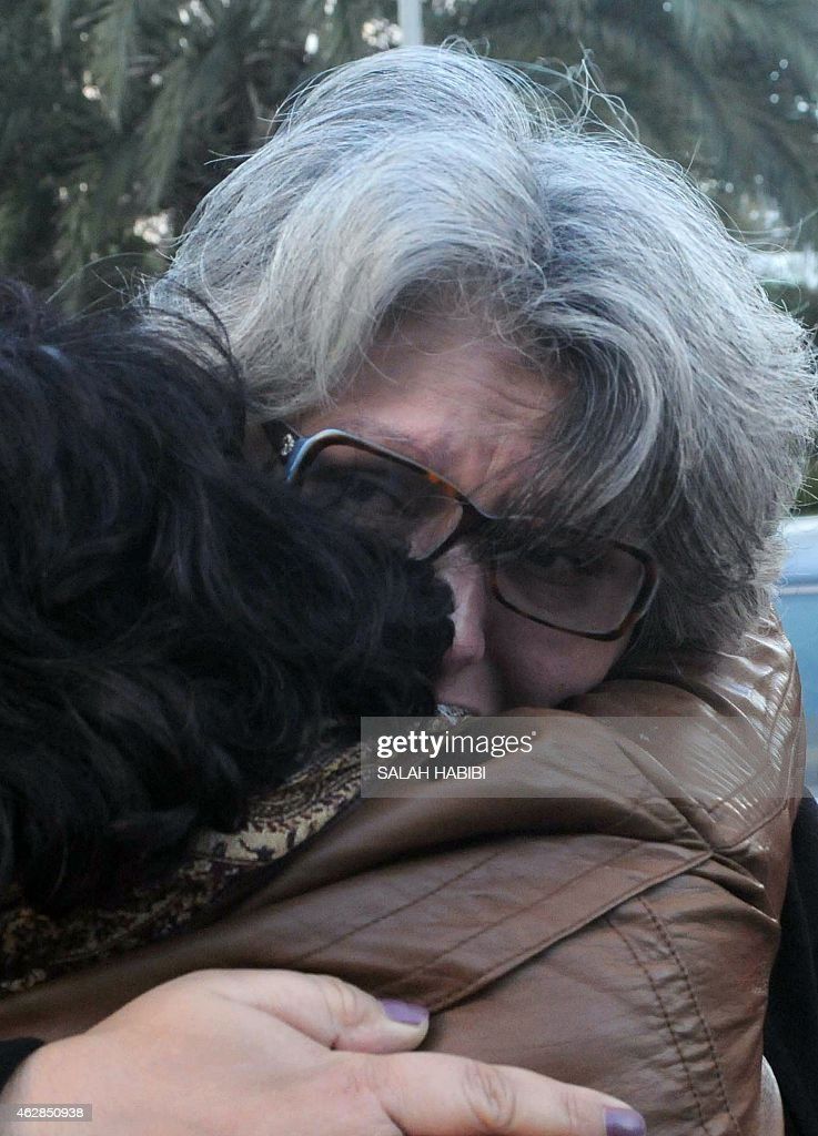 The widow of murdered Tunisian opposition figure Chokri Belaid, Basma Khalfaoui (R) reacts during a ceremony marking the second anniversary of his death, on February 6, 2015 in the capital Tunis. Belaid, an anti-Islamist politician, was shot dead by suspected jihadists two years ago.