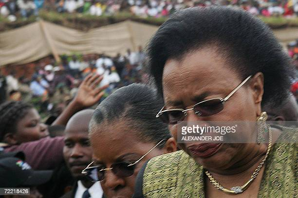 The widow of Samora Machel Grace Machel cries after laying a wreath of flowers 19 October 2006 in Mbuzni at a memorial built on a hill where Samora...