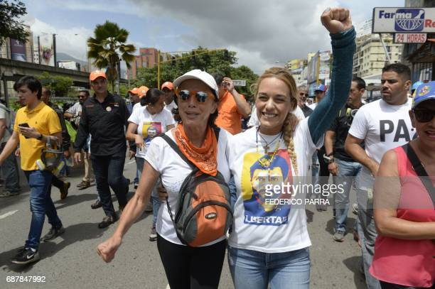 The wife and mother of imprisoned opposition leader Leopoldo Lopez Lilian Tintori and Antonieta Mendoza de Lopez respectively take part in a march...