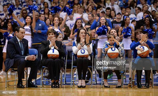 The wife daughters and grandchildren of head coach Mike Krzyzewski of the Duke Blue Devils cheer as he is honored for his 1000th career victory...