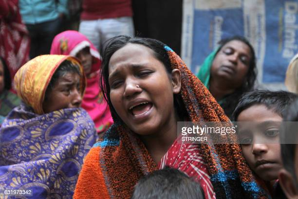The wife of 32 yearold Mofijul Khan who was shot and killed in alleged police firing weeps in Bhangar around 45 kms south east of Kolkata on January...