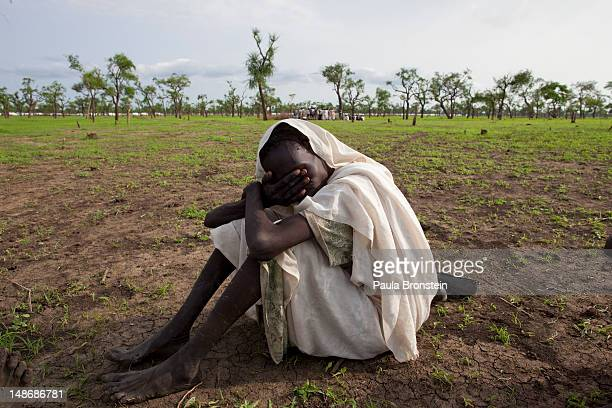 The wife of a man who died grieves as her husband is buried in a field July 19 2012 in Jamam refugee camp South Sudan Up to 16000 refugees are in the...