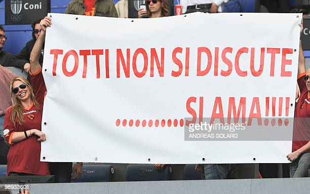 The wife of AS Roma's forward Francesco Totti Ilary Blasi holds a banner reading 'Totti don't discuss him love him'before the AS Roma Italian Serie A...