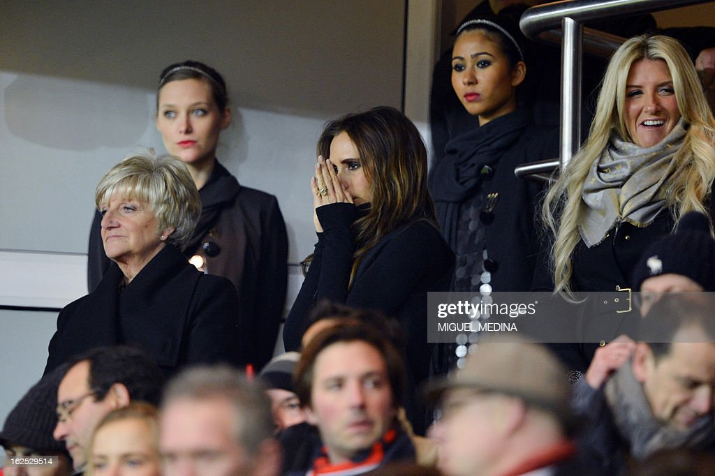 The wife of British football player David Beckham, Victoria Beckham (C) is pictured in the stands with David Beckham's mother Sandra Beckham and sister Joanne Beckham during the French L1 football match Paris Saint-Germain (PSG) vs Olympique de Marseille (OM) on February 24, 2013 at the Parc des Princes stadium in Paris. AFP PHOTO MIGUEL MEDINA