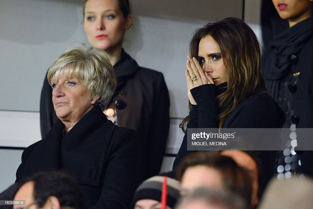 The wife of British football player David Beckham, Victoria Beckham (R) is pictured in the stands with David Beckham's mother Sandra Beckham during the French L1 football match Paris Saint-Germain (PSG) vs Olympique de Marseille (OM) on February 24, 2013 at the Parc des Princes stadium in Paris.