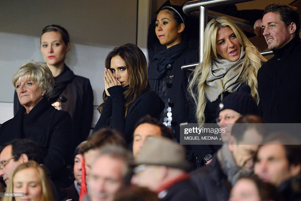 The wife of British football player David Beckham, Victoria Beckham (C) is pictured in the stands with David Beckham's mother Sandra Beckham (L) and sister Joanne Beckham (R) during the French L1 football match Paris Saint-Germain (PSG) vs Olympique de Marseille (OM) on February 24, 2013 at the Parc des Princes stadium in Paris.