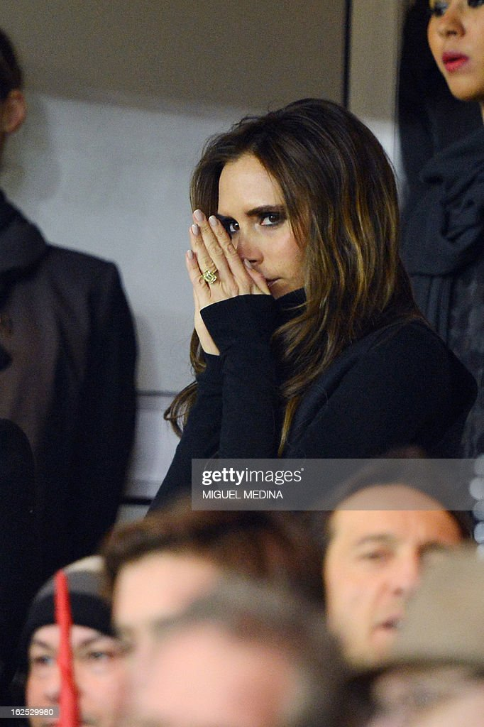 The wife of British football player David Beckham, Victoria Beckham (C) is pictured in the stands during the French L1 football match Paris Saint-Germain (PSG) vs Olympique de Marseille (OM) on February 24, 2013 at the Parc des Princes stadium in Paris.