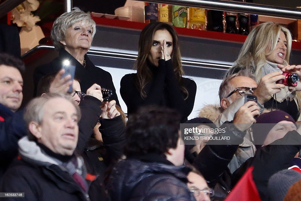 The wife of British football player David Beckham, Victoria Beckham (top C) is pictured in the stands with David Beckham's mother Sandra Beckham (L) and sister Joanne Beckham (R) during the French L1 football match Paris Saint-Germain (PSG) vs Olympique de Marseille (OM) on February 24, 2013 at the Parc des Princes stadium in Paris. AFP PHOTO KENZO TRIBOUILLARD