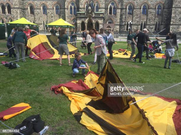 The wife of Canada's prime minister Sophie GregoireTrudeau and their daughter Ella Grace set up a tent on parliament's front lawn on May 12 2017 in...