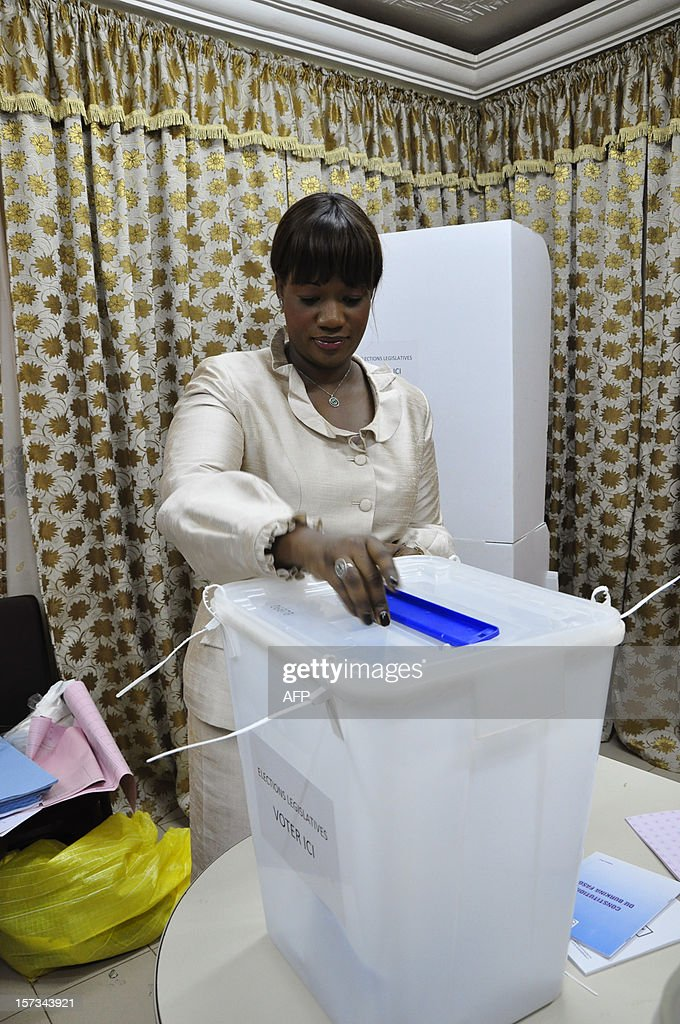 The wife of Francois Compaore, the brother of Burkina Faso incumbent President Blaise Compaore, casts his ballot at a polling station in Ouagadougou during legislative and municipal elections, on December 2, 2012. Voters cast ballots in the legislative and municipal elections in Burkina Faso, a test case a year and a half after violence that almost toppled the administration of President Blaise Compaore. AFP PHOTO / AHMED OUOBA