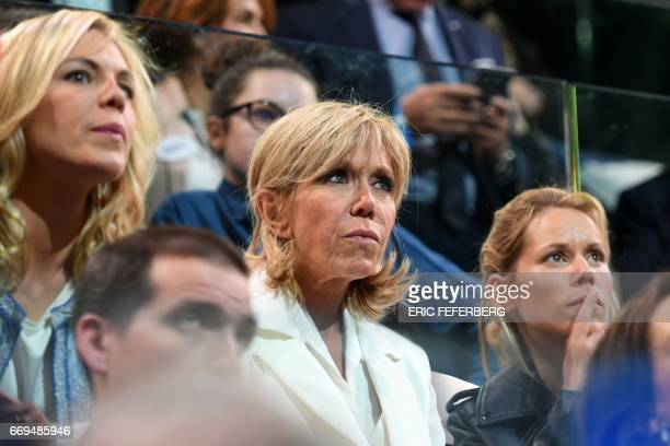 The wife of French presidential election candidate for the En Marche movement Emmanuel Macron Brigitte Trogneux and her daughters Tiphaine Auziere...
