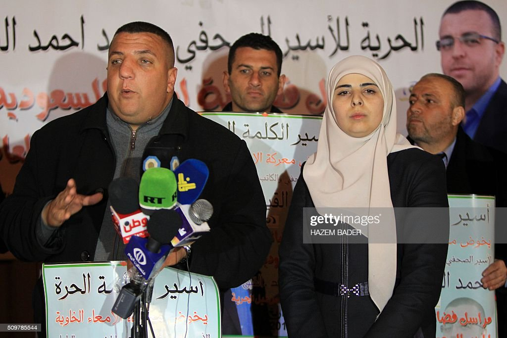 The wife of hunger striking Palestinian prisoner Mohammed al-Qiq, Fayha Shalash (R), and his brother speak during a press conference in the West Bank town of Hebron on February 12, 2016. Qiq, 33, a correspondent for Saudi Arabia's Almajd TV network, was arrested on November 21 at his home in the West Bank city of Ramallah and placed under administrative detention, an Israeli procedure allowing indefinite imprisonment without trial. / AFP / HAZEM BADER