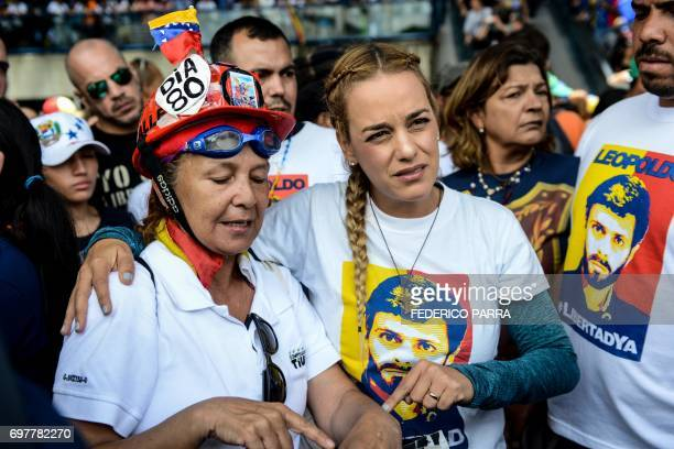The wife of imprisoned opposition leader Leopoldo Lopez Lilian Tintori joins thousands of opposition activists protesting against the government of...