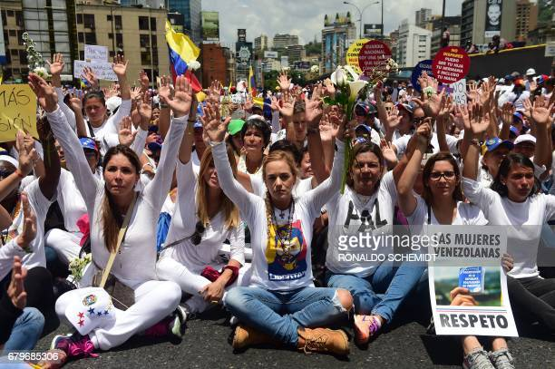 The wife of imprisoned opposition leader Leopoldo Lopez Lilian Tintori takes part in a women's march aimed to keep pressure on President Nicolas...