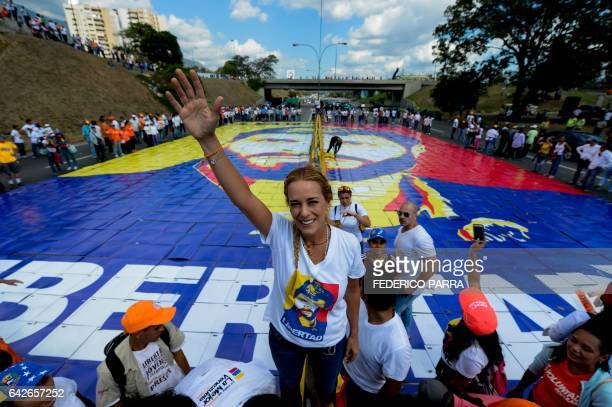 The wife of jailed Venezuelan opposition leader Leopoldo Lopez Lilian Tintori stands on top of a giant image of him during a demonstration held on...