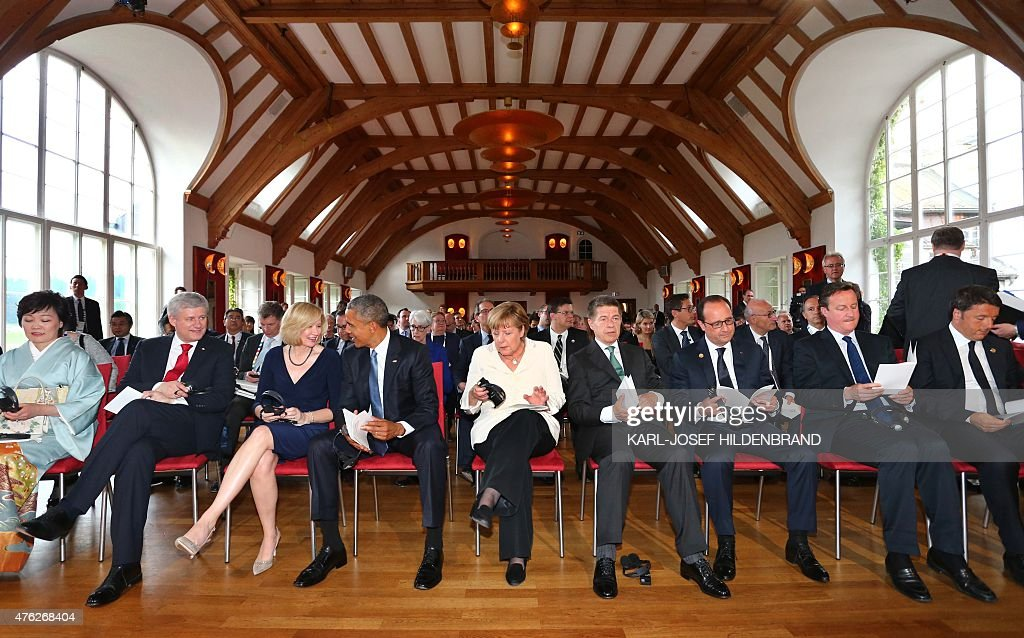 The wife of Japanese Prime Minister Akie Abe, Canada's Prime Minister Stephen Harper, his wife Laureen Harper, US President Barack Obama, Germany's Chancellor Angela Merkel, her husband Joachim Sauer, French President Francois Hollande, British Prime Minister David Cameron and Italy's Prime Minister Matteo Renzi attend a concert at the G7 summit at Schloss Elmau hotel near Garmisch-Partenkirchen, southern Germany, on June 7, 2015.