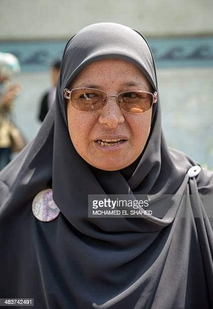 The wife of leading Egyptian Muslim Brotherhood senior member Mohamed Beltagi stands outside the police institute near Cairo's Turah prison in...