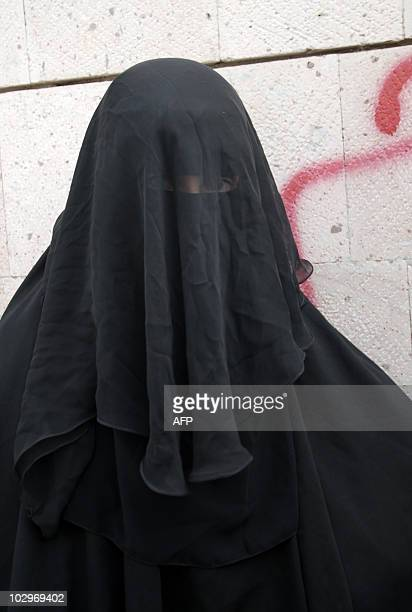 The wife of murdered Yemeni Jew Masha Yaeish alNahari joins a protest outside the ministry of justice in Sanaa on June 28 2010 to demand a final...