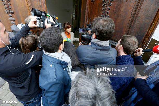 The wife of Paul Bekaert lawyer of Catalan separatist leader Carles Puigdemont speaks to the press from the doorstep of their house following the...