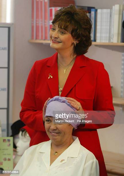 The wife of Prime Minister Tony Blair and Breast Cancer Care Patron Cherie Blair ties a headscarf for Ollwyne Lowbridge after opening the charity's...